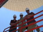 David, Lew, and David climbing aboard the DSS-14 structure