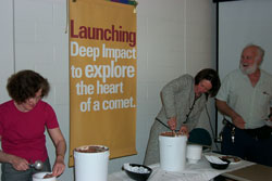 Deep Impact PI Mike A'Hearn coaches University of Maryland's Provost, Ann Wylie, and science team member, Lucy McFadden, in scooping Comet Crunch ice cream for its debut at the University.