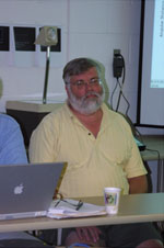 Fig. 11 Jay Melosh (U. Arizona) listens to discussion about the impact and post impact sequence.