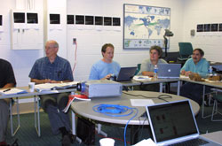 Fig. 4 Members of the science team working on the sequence review. From left to right, Ken Klaasen (JPL), Tony Farnham (UMd), Jessica Sunshine (SAIC), Pete Schultz (Brown University).